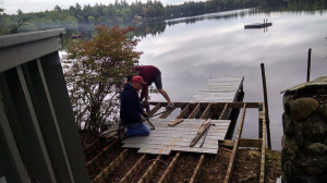 Taking apart the old dock with the help of our neighbors.