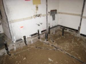 New plumbing in the downstairs men's bathroom.