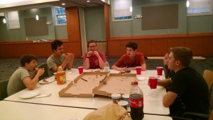Part of the chair-washing crew enjoys the First Supper in the new Great Hall