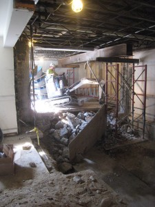 """View from the bathroom area. Good view of the """"shoring"""" that supports the office and hallway outside the office."""